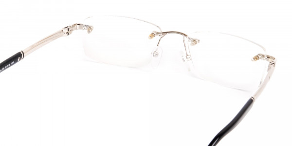 silver and black rectangular rimless glasses frames-5